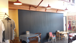A new coat for the blackboard and oak shelving.